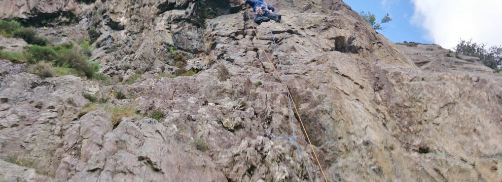 Getting into position and placing gear just before the crux