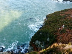 Such beautiful clear water below the steep cliffs of Anglesey