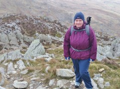 Lindsey looking relaxed on the east ridge of Pen ye Ole Wen