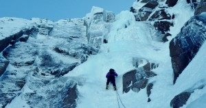 Ice climbing in the Cairngorms. Coire An t-Sneachda on Aladdin's Buttress on Mirror direct with a good build up of ice.