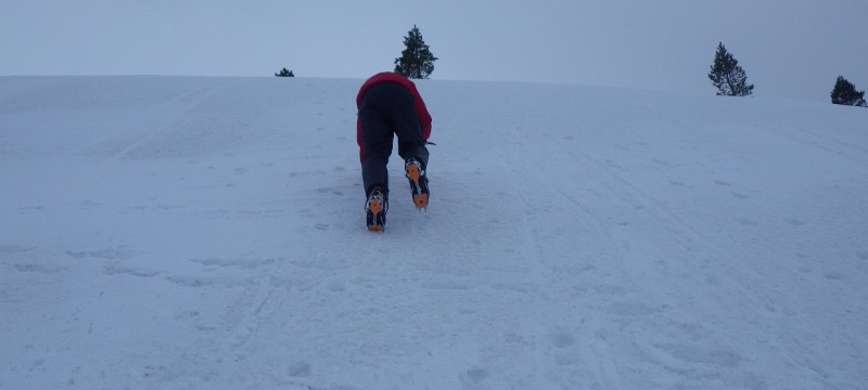 Winter skills course in Scotland.  Practicing cramponing on a steep snow slope