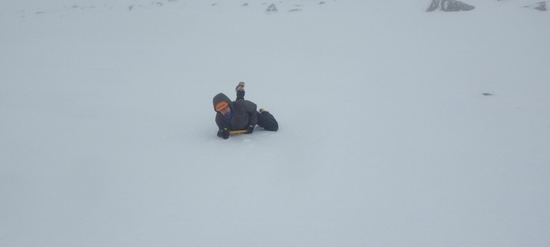 Winter skills course in Scotland.  Practicing ice axe arresting on a steep slope
