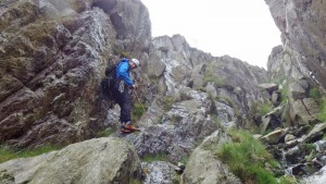 Rock scrambling in Snowdonia. Reaching the bottom of Nor Nor groove on the east face of Tryfan