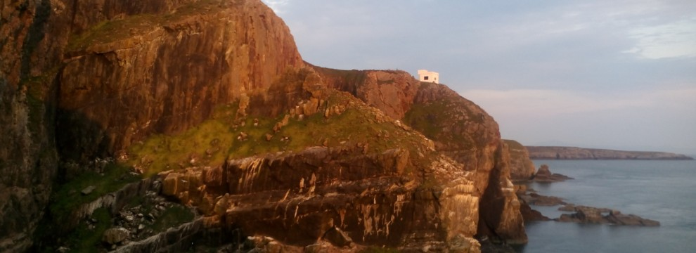 Walking on the Anglesey coastal path at South Stack. This is the famous climbing cliff The mouse trap area