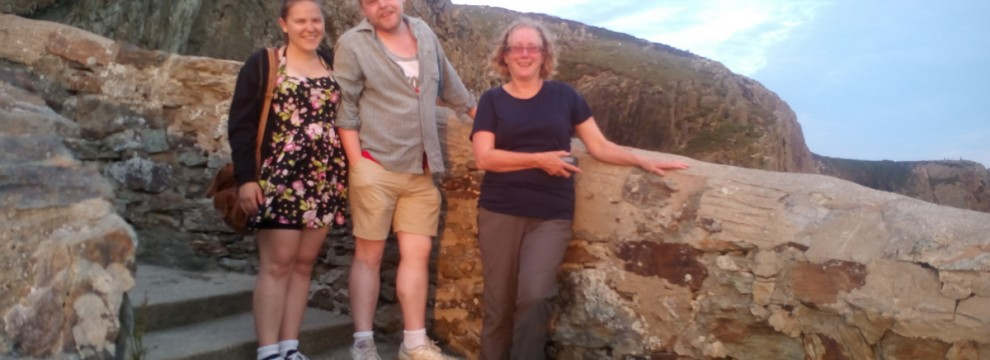 Walking on the Anglesey coastal path Tom Megan and San in the evening sun