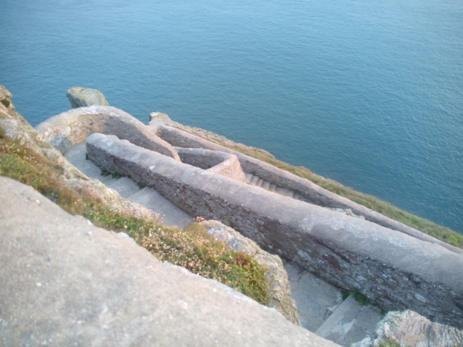 Walking on the Anglesey coastal path steep stairs down to the lighthouse