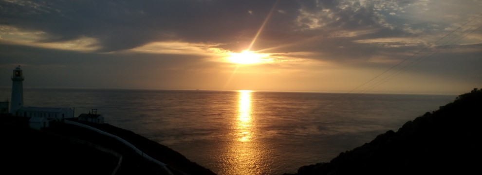 Walking on the Anglesey coastal path as sunset approaches with Mountaineering Joe