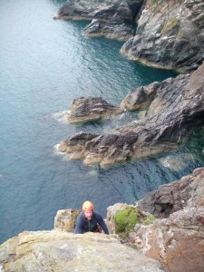 Anglesey Coastal path.  You can watch rock climbers climbing the sea cliffs as you walk