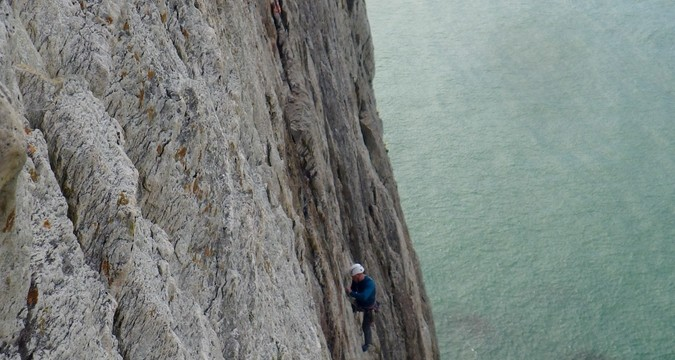 Mike belaying on the second pitch Dream of the white horses