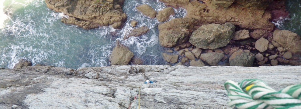 Rock climbing on the Anglesey sea cliffs. Dream of the white horses Belaying at Wen Chimney