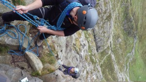 Here Sam is using an Italian Hitch is bring up his partner and will convert this to a Clove Hitch to secure her