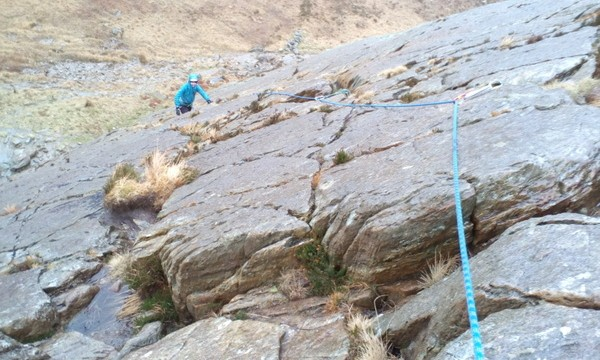 Rock scrambling in Snowdonia Rope work practice on steep grade 3 ground