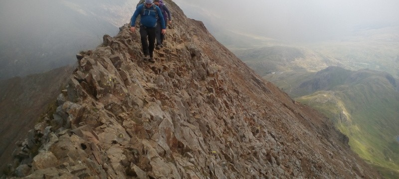 Rock scrambling in Snowdonia crossing the main ridge
