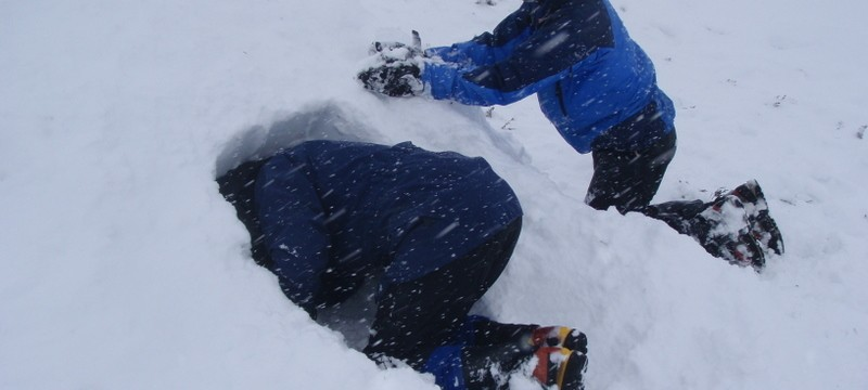 Building snow shelters, Cairngorms, Scotland.