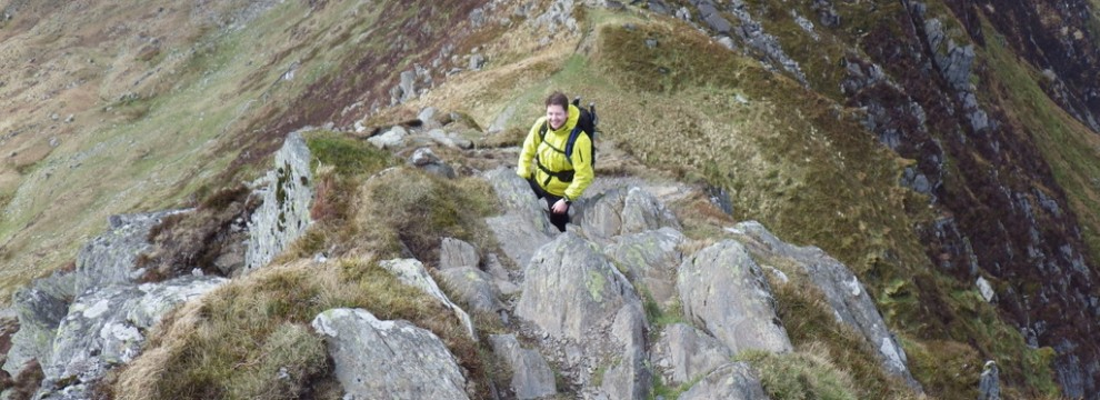 Nick scrambling up a steep arete
