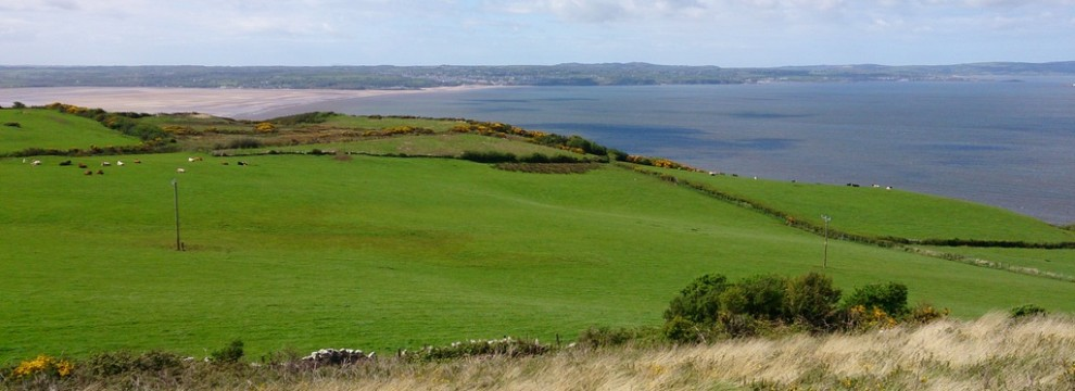 The view from Bwrdd Arthur with Red Wharf Bay in the distance