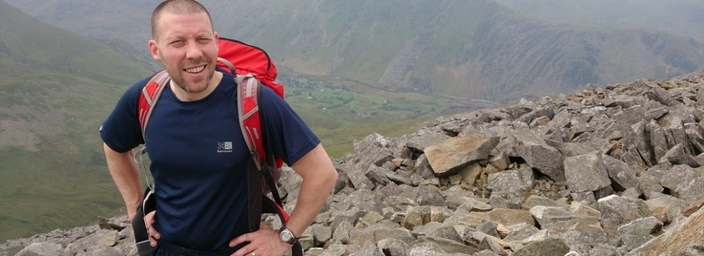 Greg reaching the summit of Elidir Fawr