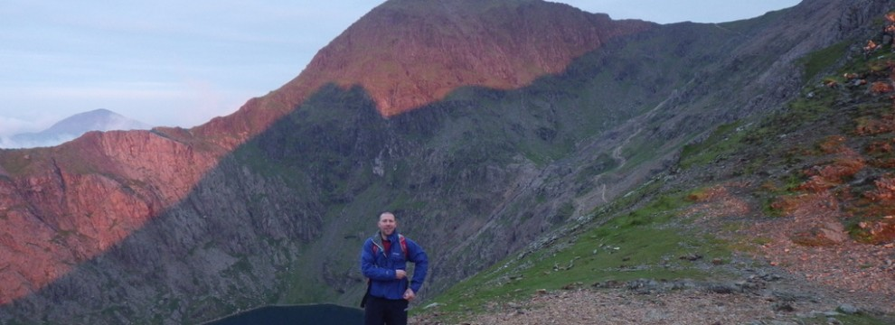 Greg looking confident after Crib Goch ridge with Snowdon in the background
