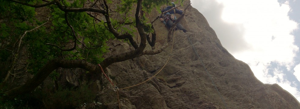Climbing out with exposed moves on the main rib