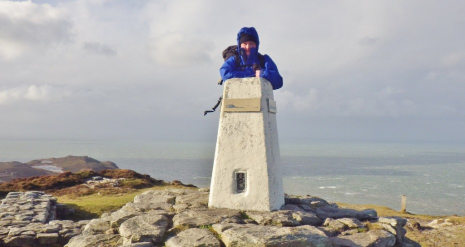 On the Anglesey Coastal Path at the Holyhead Mountain summit braving the high winds