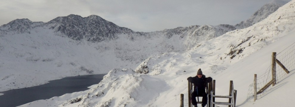 A winter transverse of Crib Goch in Snowdonia relaxing on the Pyg Track