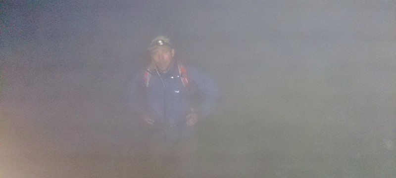Welsh 3000s (14 peaks) Challenge.  Starting up Crib Goch ridge at 3 in the morning foggy and no moon so head torches a must!