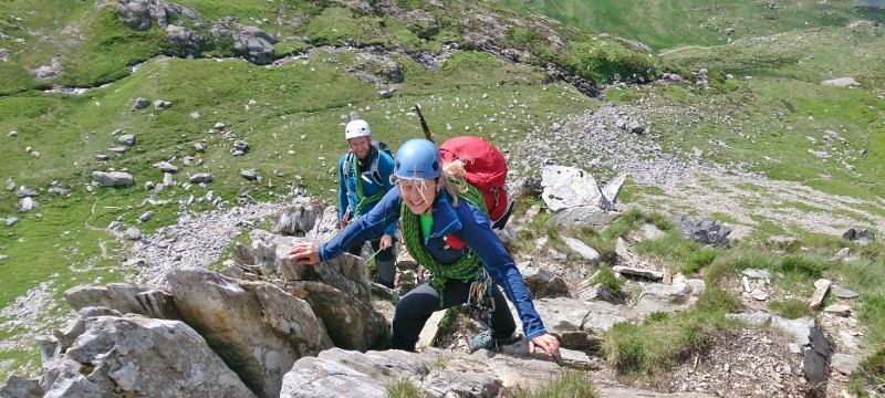 Sarah leading the upper pitches on rock scramble Cneifion Arête