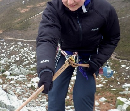 The correct use of a sling to extent the belay plate