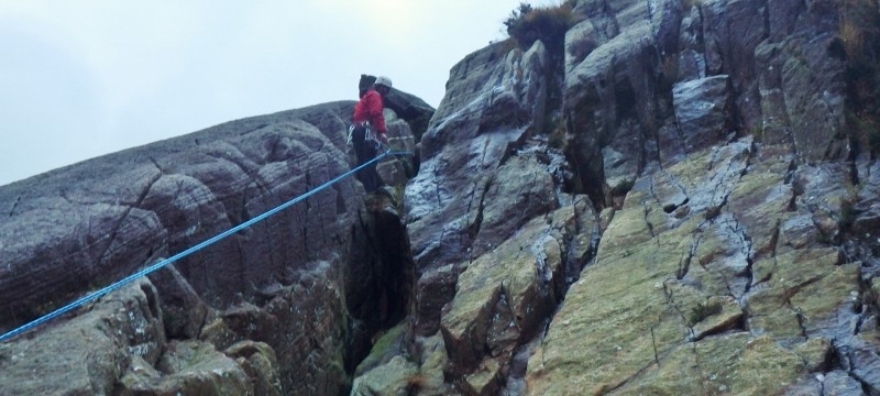 setting up multiables abseils down ther rock face