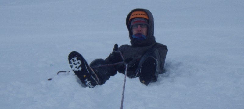 Winter skills course in Scotland.  Practicing buckets seats on a snow slope