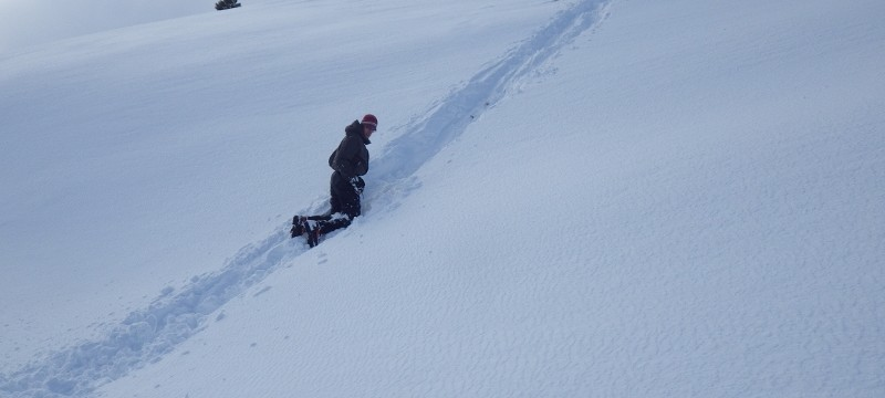 Winter skills course in Scotland.  Practicing ice axe arresting