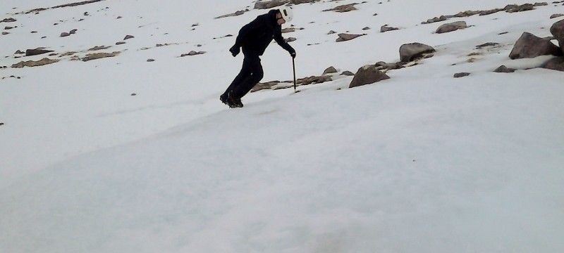 Winter skills in Scotland front pointing up a slope
