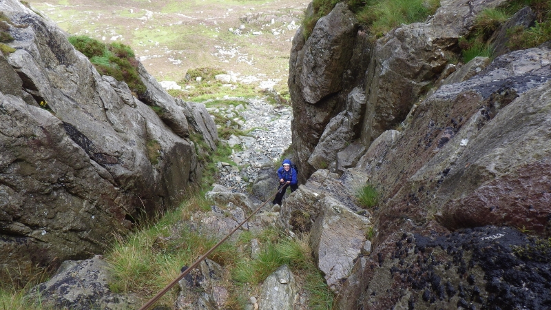 Rock scrambling in Snowdonia. Multi pitch abseiling down the east face of Tryfan.