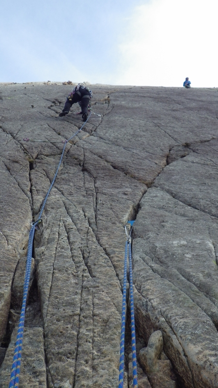 Rock climbing in Snowdonia placing gear in the right places to avoid rope drag