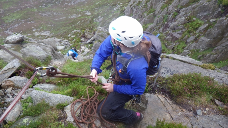 Rock scrambling in Snowdonia. Using an Italian hitch to protect a scrambling pitch