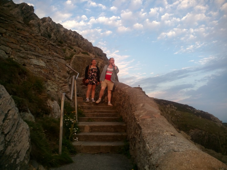 Walking on the Anglesey coastal path Tom and Megan taking the stairs down to the light house on South stack