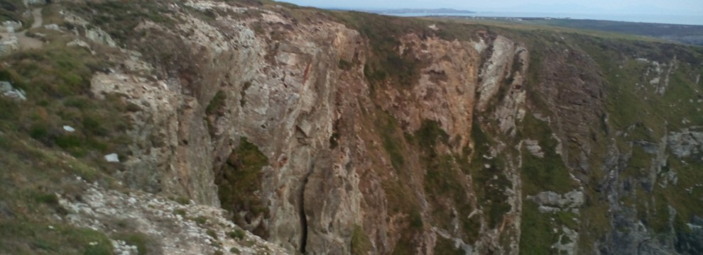 Walking on the Anglesey coastal path with its steep cliffs beautiful cliffs