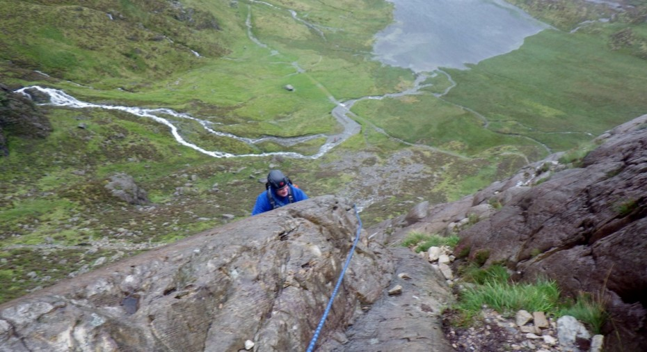Rock scrambling in Snowdonia Kevin practicing rope techniques on grade 3 ground