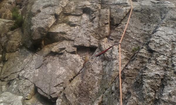 Rock climbing in Ogwen Valley on Clogwyn Bochlwyd  High up on Marble Slab