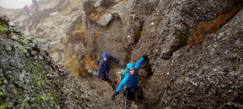 Rock scrambling in Snowdonia on the North ridge of Tryfan just below the summit