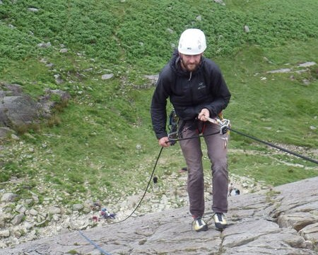 Trad rock climbing learning to abseil safely