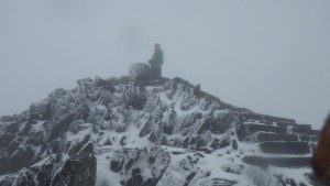 Winter walking in Snowdonia with Max on the summit in poor visibility