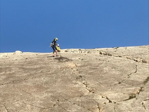 Emma learning to abseil safely and retrieve her rope from the top of the rock climb