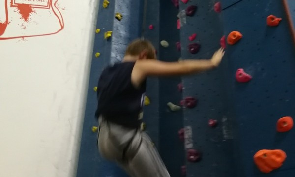 Luca blasting up the climbing wall