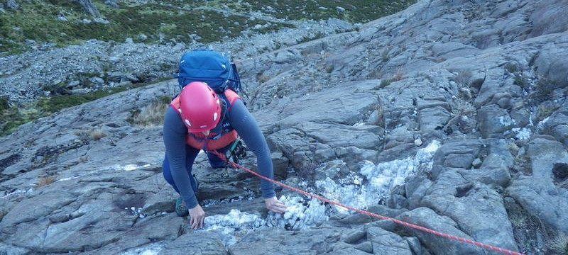Rock scrambling in Snowdonia A long way down so ropes are essential