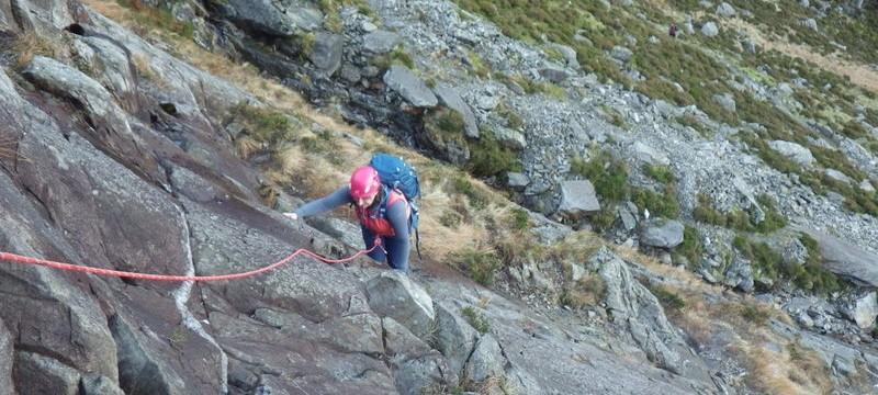 Rock scrambling in Snowdonia Katie on grade 2 ground