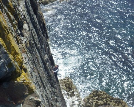 Rock climbing on the South stack sea cliffs traversing across to the arete of Lighthouse...... atmospheric!