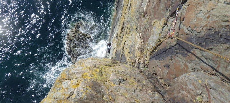 Rock climbing on the South stack sea cliffs climbing on the main wall below the corner